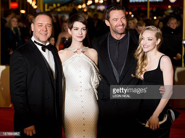 Russell Crowe Anne Hathaway Hugh Jackman and Amanda Seyfried pose for photographers on the red carpet ahead of the world premiere of 'Les Miserables'...