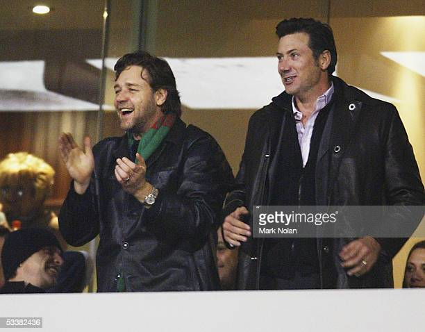 Russell Crowe celebrates a Rabbitohs try during the round 23 NRL match between the Canberra Raiders and the South Sydney Rabbitohs at Canberra...