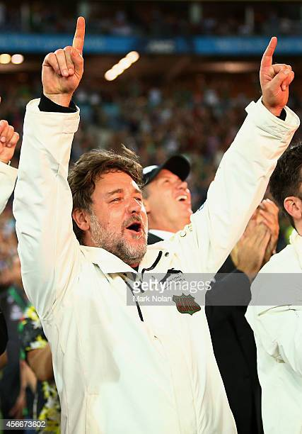 Russell Crowe celebrates the Rabbitohs winning the 2014 NRL Grand Final match between the South Sydney Rabbitohs and the Canterbury Bulldogs at ANZ...
