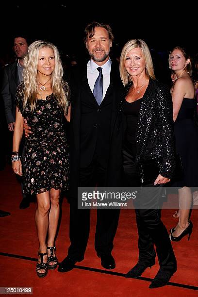 Russell Crowe Danielle Spencer and Olivia NewtonJohn arrive at the opening of The Star formerly Star City in Pyrmont on September 15 2011 in Sydney...
