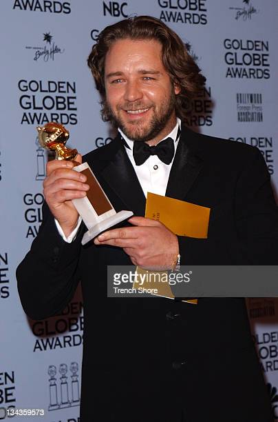 Russell Crowe holds his award for Best Actor in a Motion Picture Drama for his role in A Beautiful Mind at the 59th Annual Golden Globe Awards...