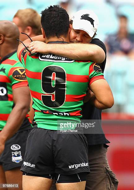 Russell Crowe hugs Issac Luke of the Rabbitohs before the round one NRL match between the South Sydney Rabbitohs and the Sydney Roosters at ANZ...