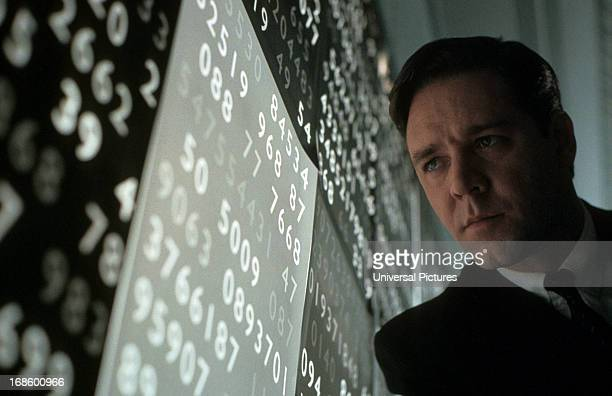 Russell Crowe looking at wall of numbers in a scene from the film 'A Beautiful Mind' 2001