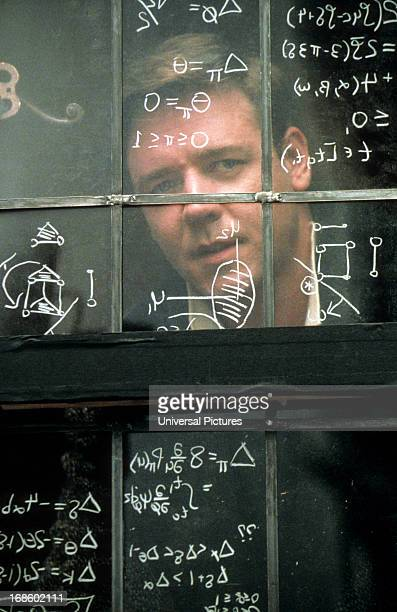 Russell Crowe looking out window in a scene from the film 'A Beautiful Mind' 2001