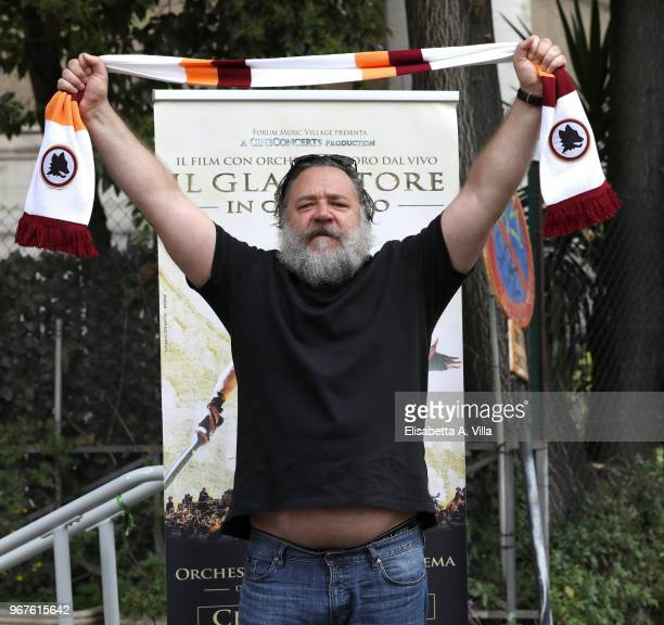 Russell Crowe poses with AS Roma football club scarf as he attends the 'Il Gladiatore In Concerto' presentation on June 5 2018 in Rome Italy