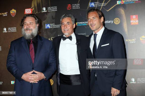 Russell Crowe producer Marco Patrignani and Francesco Totti attend the 'Il Gladiatore In Concerto' charity night at Colosseum on June 6 2018 in Rome...