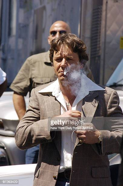 Russell Crowe smokes a cigarette as he films scenes for his new movie American Gangster at 12th Ave and W 125th St