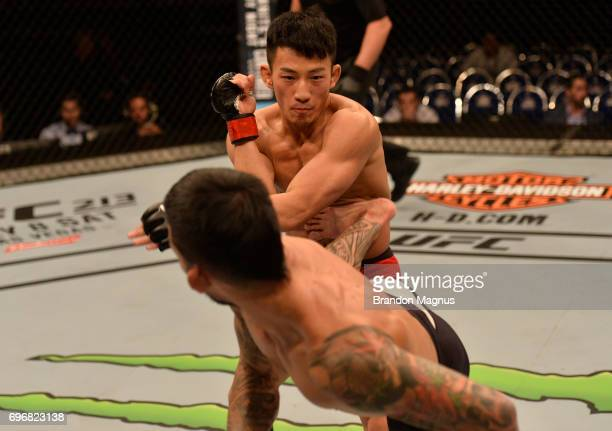 Russell Doane kicks Kwan Ho Kwak of South Korea in their bantamweight bout during the UFC Fight Night event at the Singapore Indoor Stadium on June...
