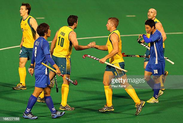 Russell Ford and Tom Wickham of Australia celebrate a goal during the International Test match between the Australian Kookaburras and Korea at Perth...
