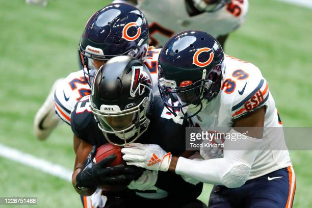 Russell Gage of the Atlanta Falcons is hit hard by Buster Skrine and Eddie Jackson of the Chicago Bears during the second quarter of an NFL game at...
