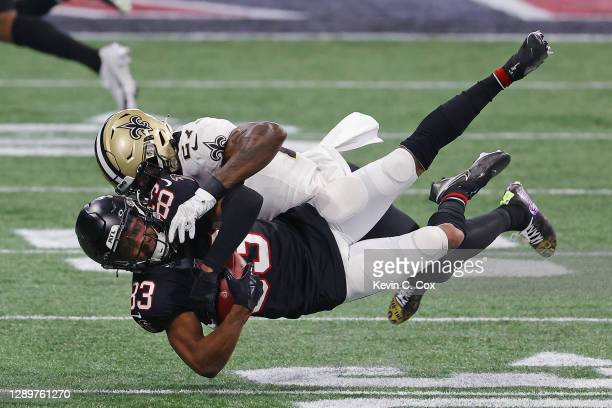 Russell Gage of the Atlanta Falcons makes the second quarter reception and is tackled by Malcolm Jenkins of the New Orleans Saints at Mercedes-Benz...