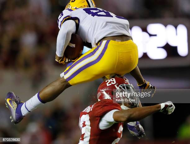 Russell Gage of the LSU Tigers hurdles Minkah Fitzpatrick of the Alabama Crimson Tide at BryantDenny Stadium on November 4 2017 in Tuscaloosa Alabama