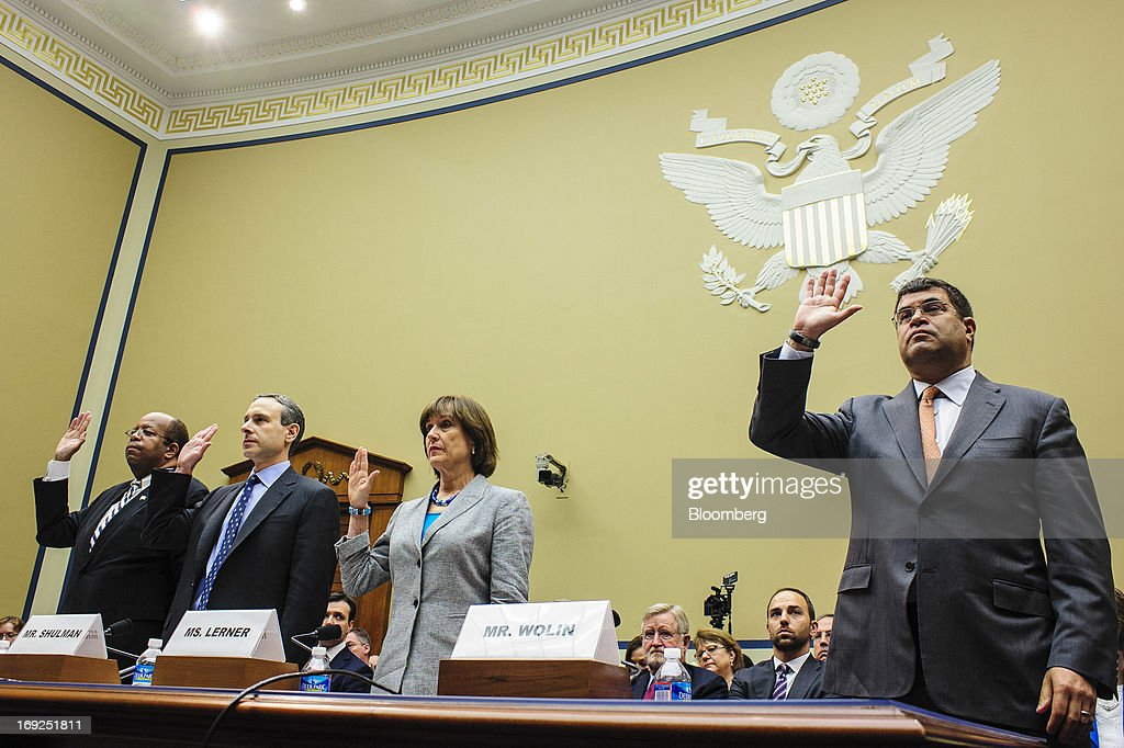 J. Russell George, U.S. Treasury inspector general for tax administration, from left, Douglas Shulman, former commissioner of the Internal Revenue Service (IRS), Lois Lerner, the director of the Internal Revenue Service's (IRS) exempt organizations office, and Neal S. Wolin, deputy secretary of the Treasury, are sworn in during a House Oversight and Government Reform Committee hearing in Washington, D.C., U.S., on Wednesday, May 22, 2013. Lerner, the mid-level IRS official at the center of a controversy over treatment of small-government groups, invoked her right not to testify after reading a statement denying that she had committed any crimes. Photographer: Pete Marovich/Bloomberg via Getty Images