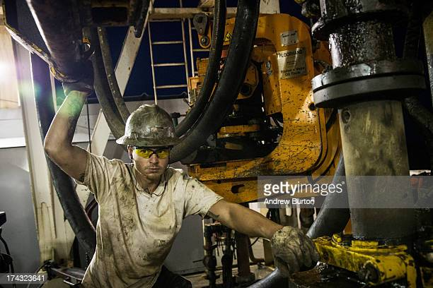 Russell Girsh a floor hand for Raven Drilling helps line up a pipe while drilling for oil in the Bakken shale formation on July 23 2013 outside...