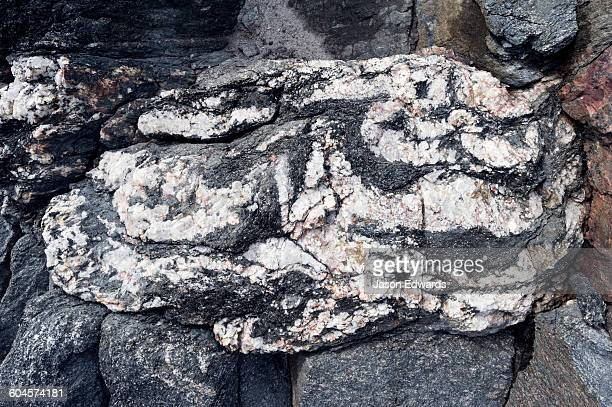 layers of quartz imbedded in a rock exposed by a receding glacier. - gneiss stock pictures, royalty-free photos & images