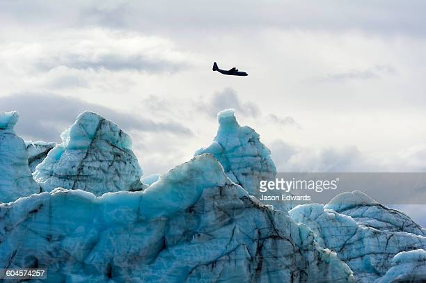 An airforce Hercules aircraft flying over the Greenland Ice Sheet.
