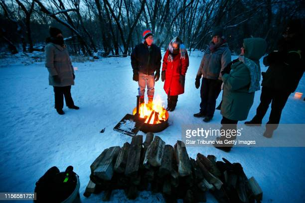 Russell Gutshe and his wife Hellen Gutsche enjoyed the warm fire during Tuesday night's New Years eve walk on candlelit trails activities at Fort...
