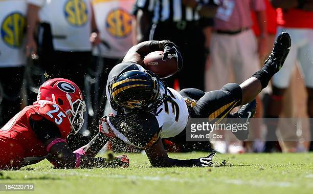 Russell Hansbrough of the Missouri Tigers draws a horsecollar penalty from Josh HarveyClemons of the Georgia Bulldogs at Sanford Stadium on October...