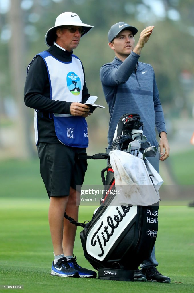 Russell Henley and caddie Todd Gjesvold line up a shot on the 10th hole during Round Three of the AT&T Pebble Beach Pro-Am at Spyglass Hill Golf Course on February 10, 2018 in Pebble Beach, California.