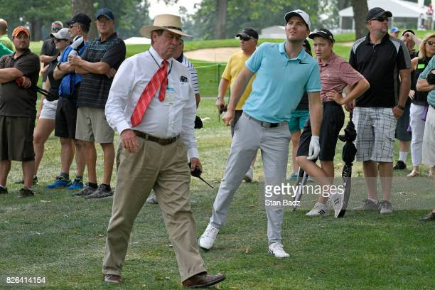 Russell Henley and rules official Slugger White look over his shot at the 16th hole during the second round of the World Golf...