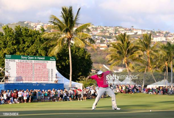 Russell Henley celebrates after making a birdie putt on the 18th hole green to win the Sony Open in Hawaii following the final round at Waialae...