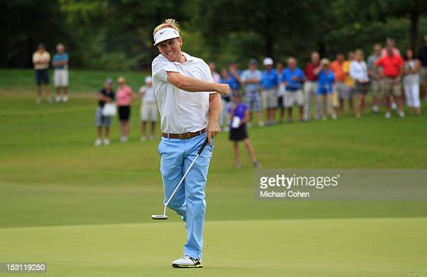 Russell Henley celebrates making a bogey putt on the 18th green to force a three way playoff during the final round of the Chiquita Classic held at...