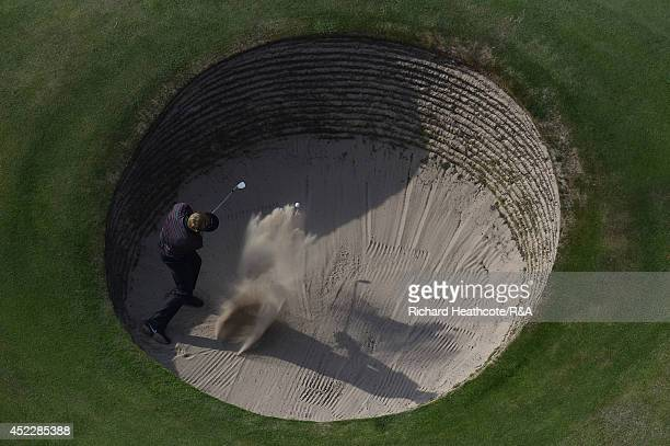 Russell Henley of the United States hits a shot from a bunker on the 15th hole during the first round of The 143rd Open Championship at Royal...