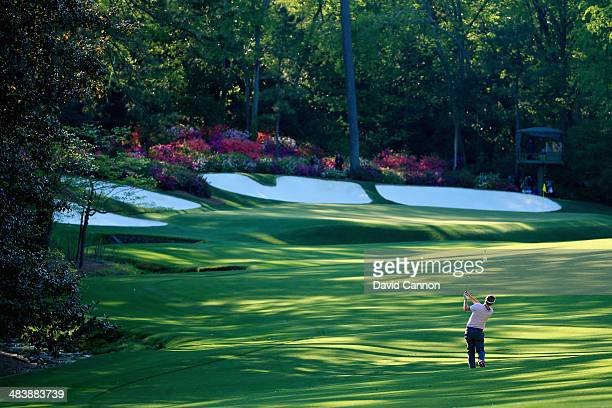 Russell Henley of the United States hits a shot on the 13th during the first round of the 2014 Masters Tournament at Augusta National Golf Club on...