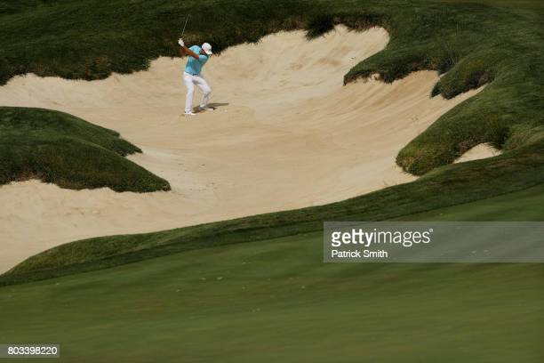 Russell Henley of the United States plays a shot from a bunker on the 18th hole during the first round of the Quicken Loans National on June 29 2017...