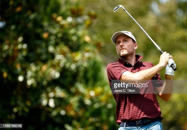 Russell Henley of the United States plays his shot from the 16th tee during the first round of the Wyndham Championship at Sedgefield Country Club on...