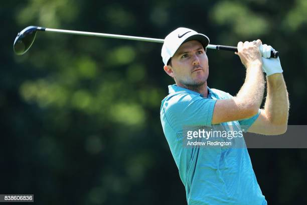 Russell Henley of the United States plays his shot from the 18th tee during round one of The Northern Trust at Glen Oaks Club on August 24 2017 in...