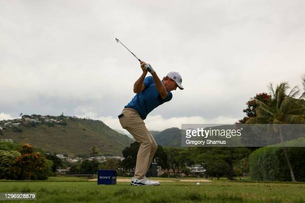 Russell Henley of the United States plays his shot from the seventh tee during the final round of the Sony Open in Hawaii at the Waialae Country Club...