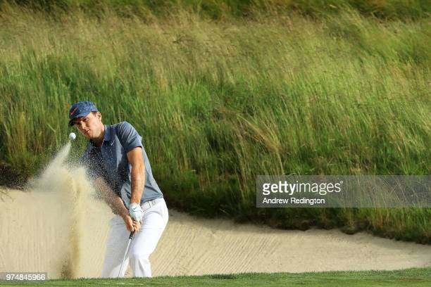 Russell Henley of the United States plays his third shot on the 18th hole during the first round of the 2018 U.S. Open at Shinnecock Hills Golf Club...
