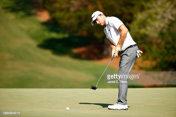 Russell Henley of the United States putts on the 18th green during the second round of the Wyndham Championship at Sedgefield Country Club on August...