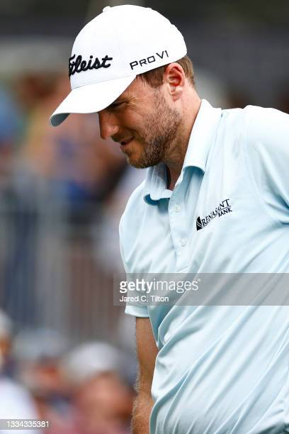 Russell Henley of the United States reacts on the 18th green during the final round of the Wyndham Championship at Sedgefield Country Club on August...