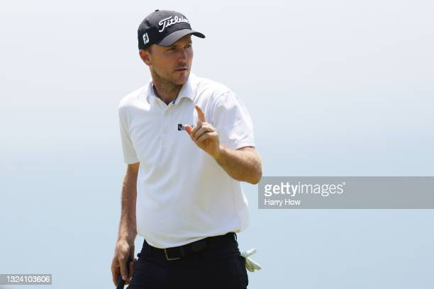 Russell Henley of the United States reacts to his par on the 17th green during the first round of the 2021 U.S. Open at Torrey Pines Golf Course on...