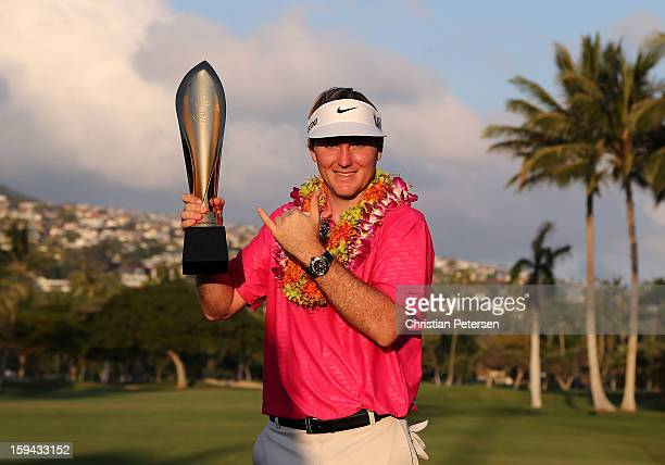 Russell Henley poses with the Sony Open in Hawaii trophy after winning in the final round at Waialae Country Club on January 13 2013 in Honolulu...