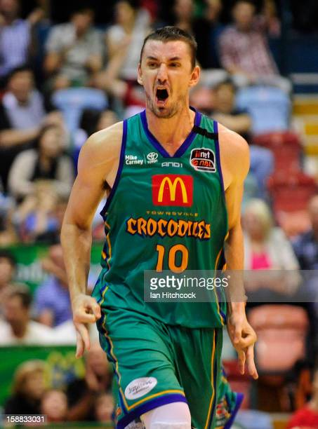 Russell Hinder of the Crocodiles celebrates after scoring a three pointer late in the final quarter during the round 12 NBL match between the...