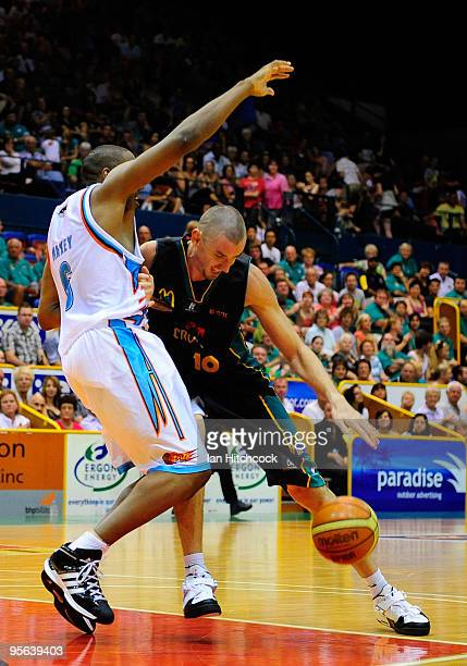 Russell Hinder of the Crocodiles drives against Erron Maxey of the Blaze during the round 15 NBL match between the Townsville Crocodiles and the Gold...