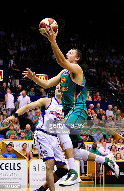Russell Hinder of the Crocodiles goes for a layup during the round 12 NBL match between the Townsville Crocodiles and the Adelaide 36ers at...
