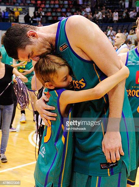 Russell Hinder of the Crocodiles is embraced by his son in his last home game before retirement at the end of the round 22 NBL match between the...
