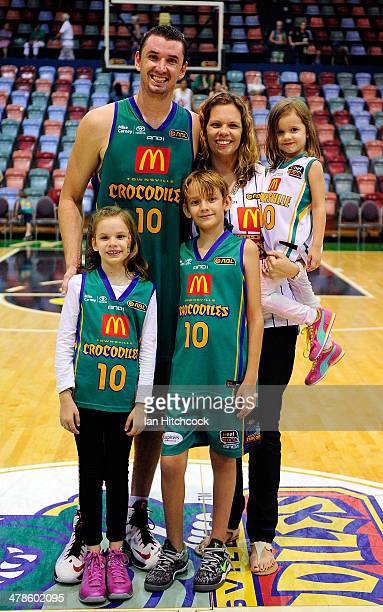 Russell Hinder of the Crocodiles poses with his family in his last home game before retirement at the end of the round 22 NBL match between the...