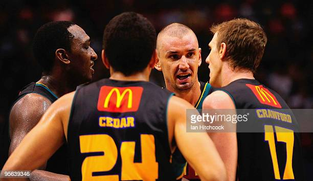 Russell Hinder of the Crocodiles talks to his team mates during the round 15 NBL match between the Townsville Crocodiles and the Gold Coast Blaze at...