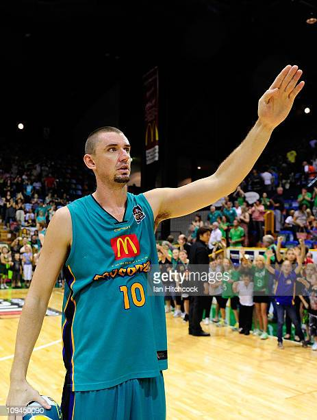 Russell Hinder of the Crocodiles waves to the crowd after winning the round 20 NBL match between the Townsville Crocodiles and the Sydney Kings at...