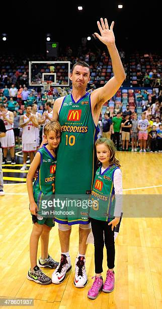 Russell Hinder of the Crocodiles waves to the crowd with his children in his last home game before retirement at the end of the round 22 NBL match...