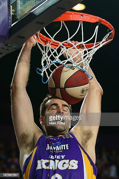 Russell Hinder of the Kings dunks during the round 21 NBL match between the Sydney Kings and the Townsville Crocodiles at Sydney Entertainment Centre...