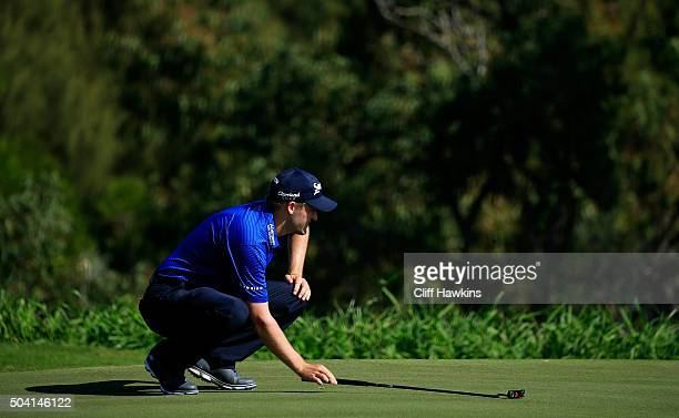 Russell Knox lines up a putt on the fourth green during round two of the Hyundai Tournament of Champions at the Plantation Course at Kapalua Golf...