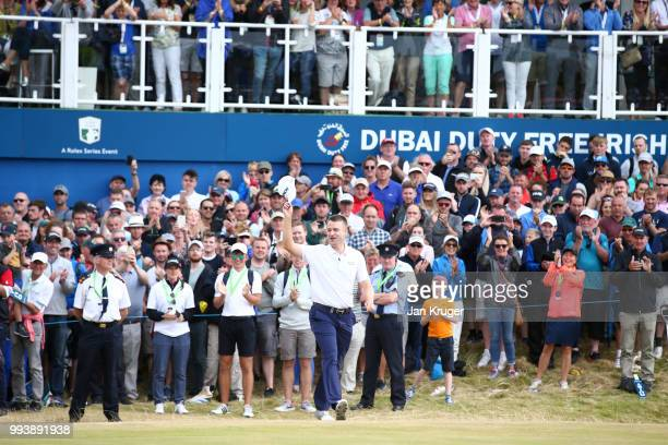Russell Knox of Scotland acknowledges the crowd following his victory on the 18th green during a playoff at the end of the final round of the Dubai...