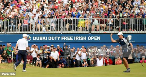 Russell Knox of Scotland celebrates his birdie on the 18th green during the final round of the Dubai Duty Free Irish Open at Ballyliffin Golf Club on...