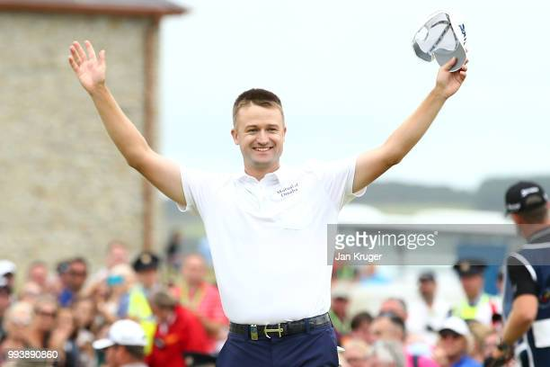 Russell Knox of Scotland celebrates his victory on the 18th green during a playoff at the end of the final round of the Dubai Duty Free Irish Open at...